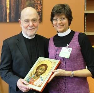 Pastor Fryer presents a hand-painted icon of Christ to Reverend Bannan.